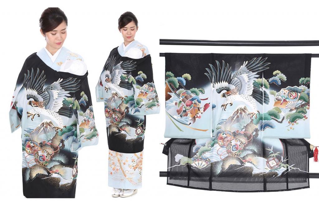 黒地に鷹と富士に松の木の絽の産着を着た女性