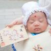 おでこに書いたお宮参りの赤ちゃん