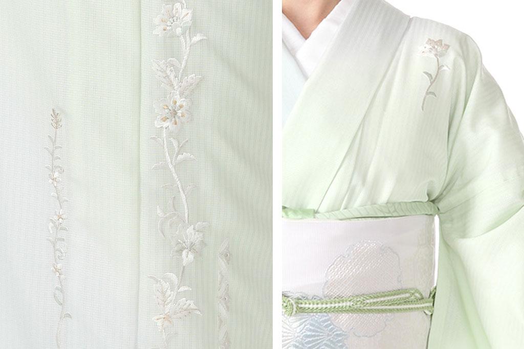 薄緑の絽の訪問着を着た女性