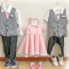 グレーのベストに白いシャツの男の子の子供服とピンクのワンピースの女の子の子供服
