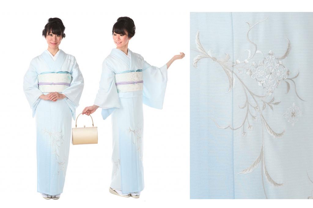 淡い水色地に唐花が刺繍で表現された夏物の訪問着を着た女性
