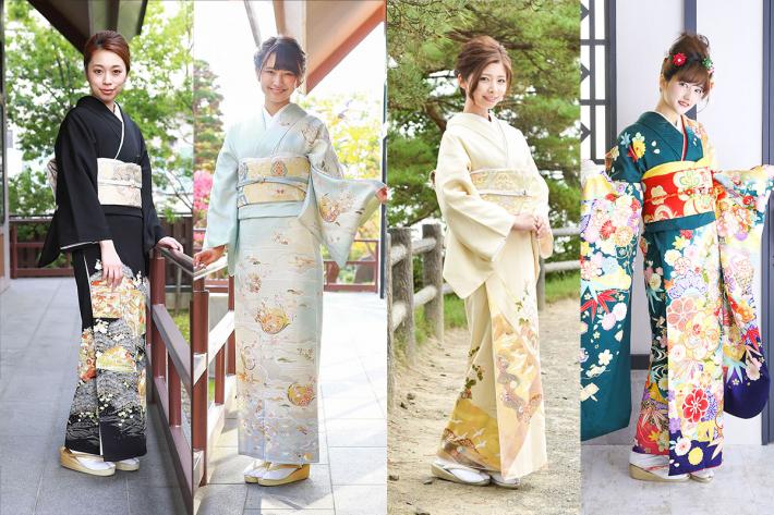 黒留袖を着た女性と水色の訪問着を着た女性と黄色の色留袖を着た女性と緑色の振袖を着た女性